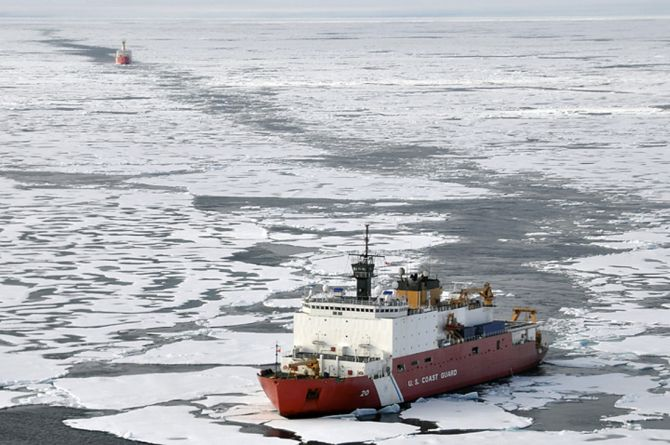 The Coast Guard Cutter Healy breaks ice ahead of the Canadian Coast Guard Ship Louis S. St-Laurent during an Arctic expedition
