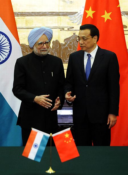 Chinese Premier Li Keqiang talks with Prime Minister Manmohan Singh during a signing ceremony at the Great Hall of the People in Beijing, on October 23