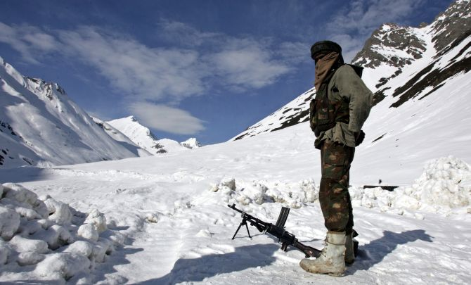 An Indian army soldier guards a mountain pass in Ladakh
