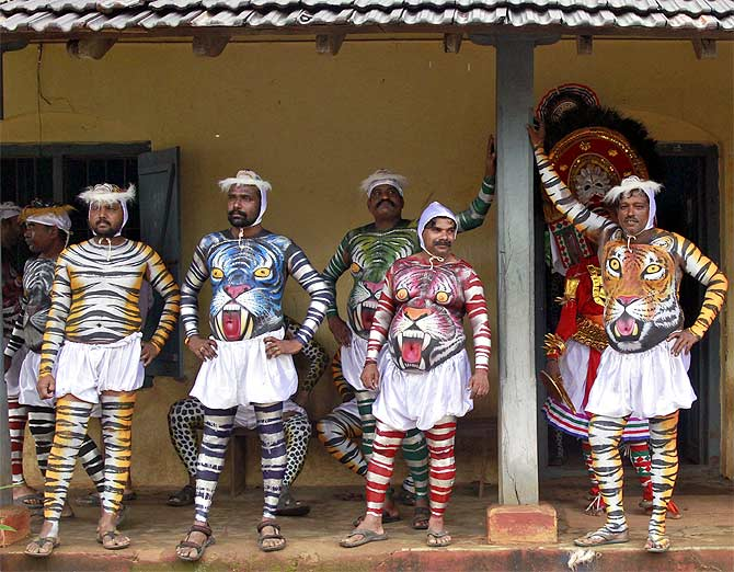 Dancers in body paint during the harvest festival of Onam in Kochi, Kerala.