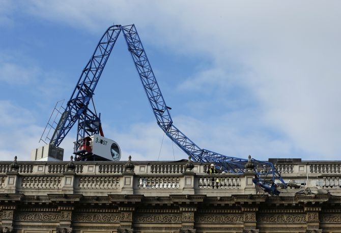 A collapsed crane lies on the roof of the Cabinet Office in London