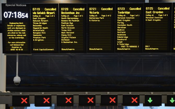 The notice board at London Bridge Station shows all trains cancelled during rush hour on Monday