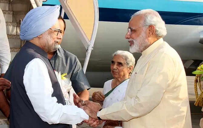Gujarat Chief Minister Narendra Modi greets Prime Minister Manmohan Singh in Ahmedabad