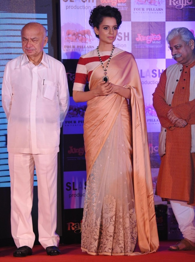 Home Minister Sushilkumar Shinde attends a music launch of the film Rajjo hours after Patna's serial blasts on Sunday. Seen in the picture along with the HIM are actors Kangana Ranaut and Atul Tiwari