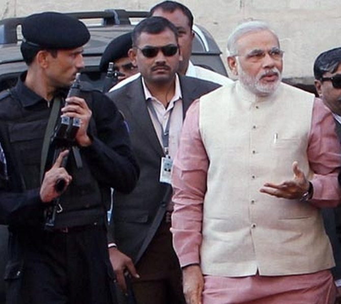 Gujarat Chief MInister Narendra Modi with his security team