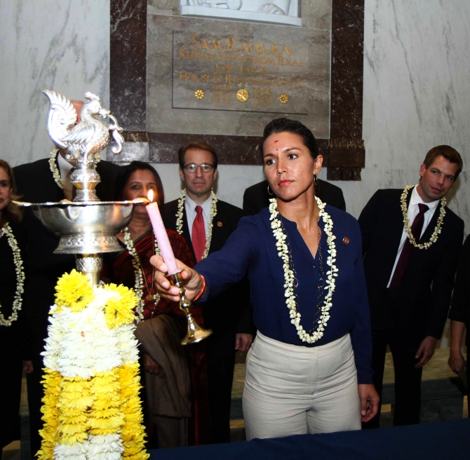 Tulsi Gabbard, Hawaii Democrat and the only Hindu American in the US Congress lights up the ceremonial diya