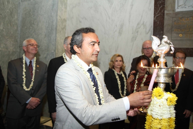 Dr Ami Bera lights up the ceremonial diya