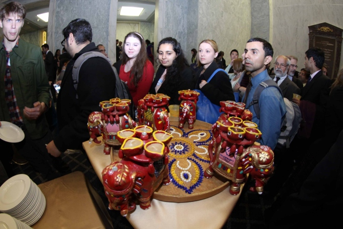 Guests admire the Diwali decorations at the Capitol Hill