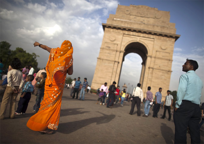 Tourists at the India Gate in Delhi.
