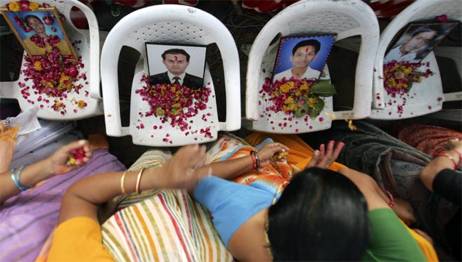 Family members of Ahmedabad blast victims participate in a prayer meet