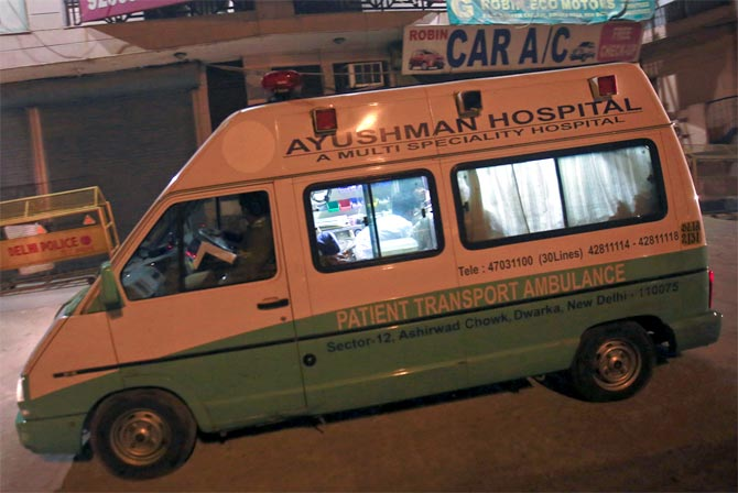 A hospital ambulance transports the body of a rape victim for cremation after it arrived from Singapore, in New Delhi December 30, 2012