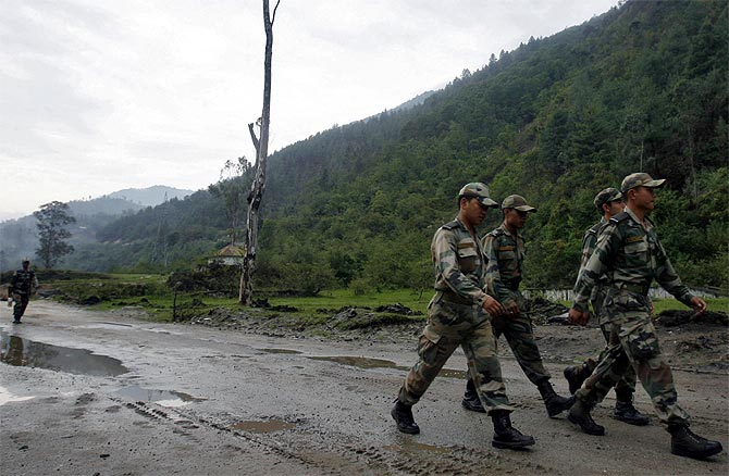Indian soldiers march near an army base on India's Tezpur-Tawang highway, which runs to the Chinese border, in Arunchal Pradesh