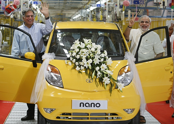 Ratan Tata, then chairman of the Tata Group, and Modi at the Tata Nano plant at Sanand in Gujarat