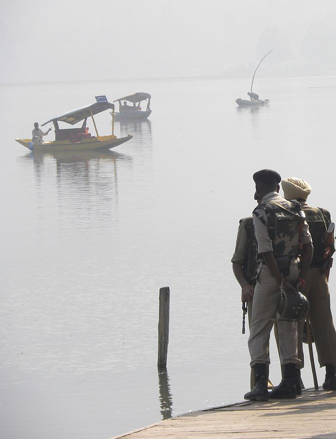 Security personnel keep vigil at the famous Dal Lake