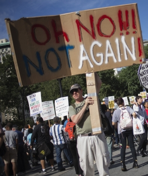 Anti-war activists hold placards after marching to Union Square in Manhattan, New York