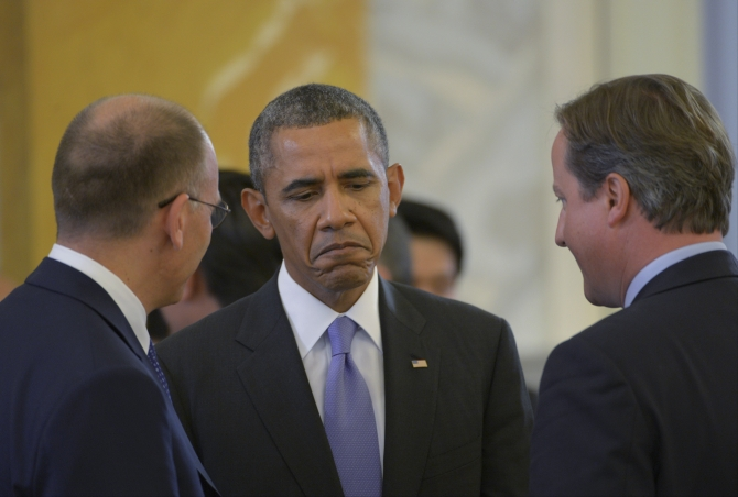 Italy's Prime Minister Enrico Letta, US President Barack Obama and British Prime Minister David Cameron at the second working session of the G20 Summit