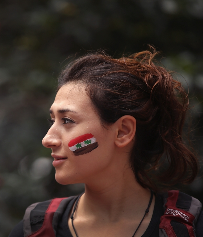 Rahaf Abuobeid, who came to the US from Syria seven months ago, participates in a protest against US intervention in Syria in Chicago