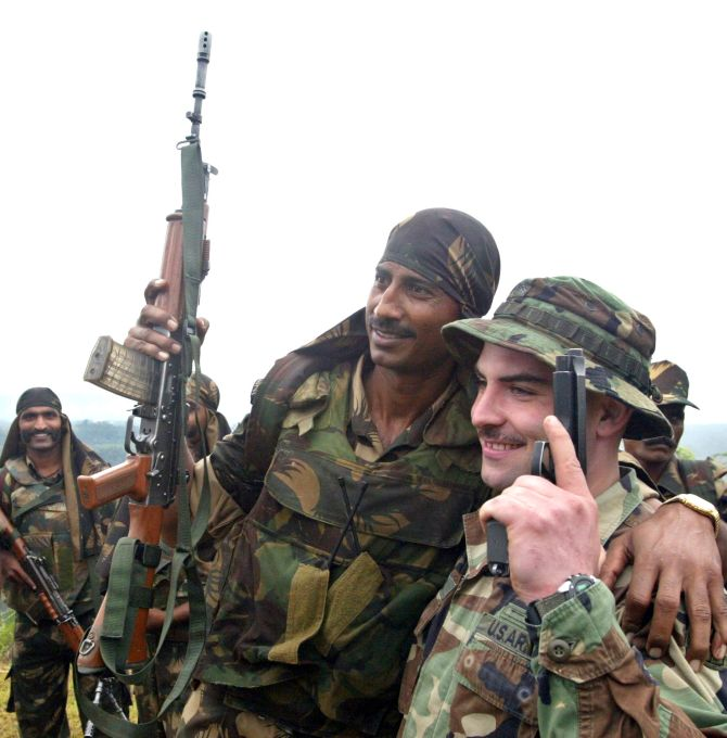 Indian and U.S. soldiers pose for pictures during a joint military exercise in Kumbhirgram