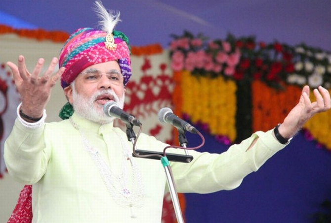 Chief Minister Narendra Modi addresses his supporters in Gujarat's Chotta Udaipur