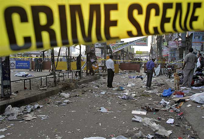 Forensic officials inspect the site of an explosion at Dilsukh Nagar in Hyderabad