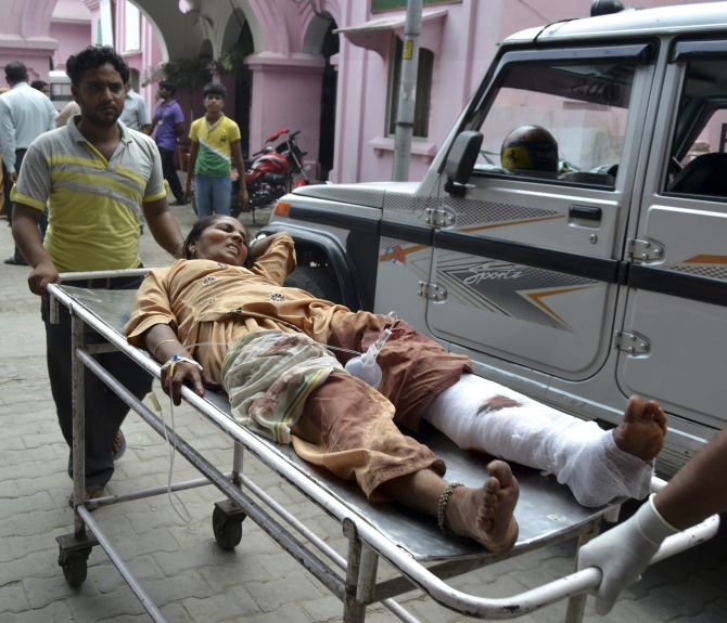 A woman who was injured in communal clashes is rushed to a hospital in Muzaffarnagar on Wednesday.