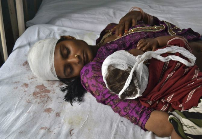 A woman and her child, who were injured in communal clashes, rest on a hospital bed in Muzaffarnagar.