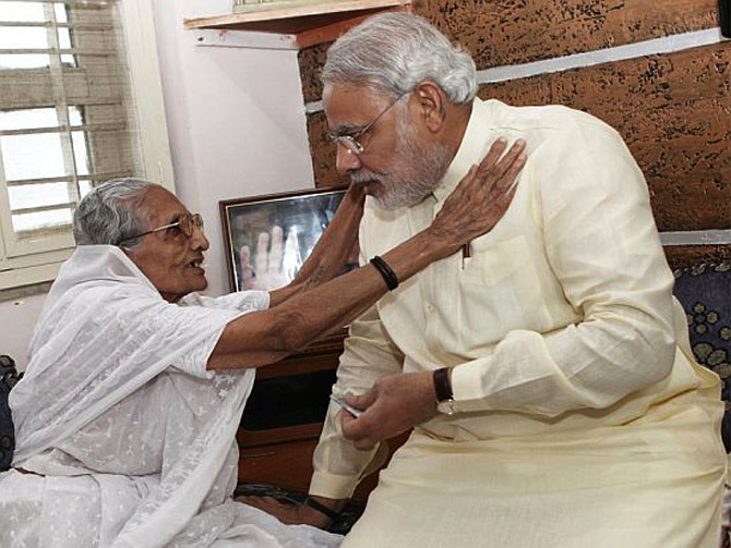 Narendra Modi seeks his mother's blessings.