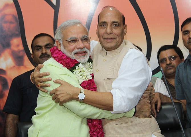 Gujarat CM Narendra Modi embraces BJP chief Rajnath Singh after his annoucement as the party's PM nominee