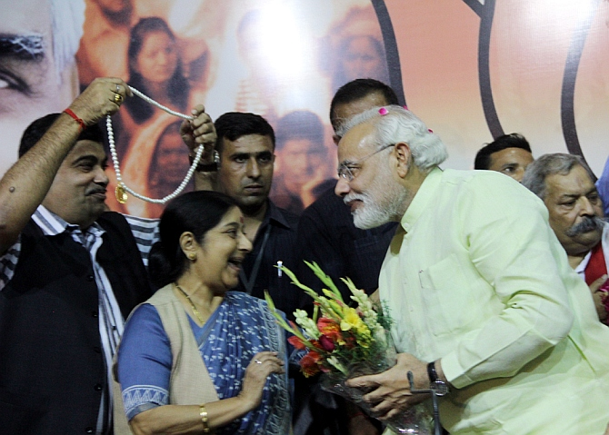Narendra Modi, left, with Sushma Swaraj and Nitin Gadkari, left