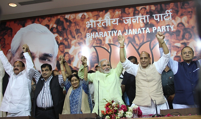 (from left) BJP leaders Venkaiah Naidu, Nitin Gadkari, Sushma Swaraj, Gujarat Chief Minister Narendra Modi, party president Rajnath Singh, and Arun Jaitley