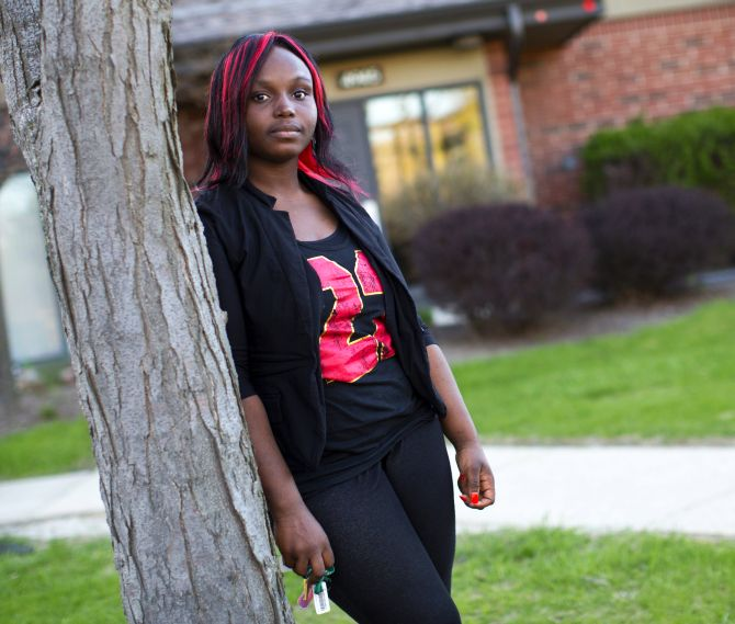 Quita Puchalla, 21, poses outside her apartment in Milwaukee.