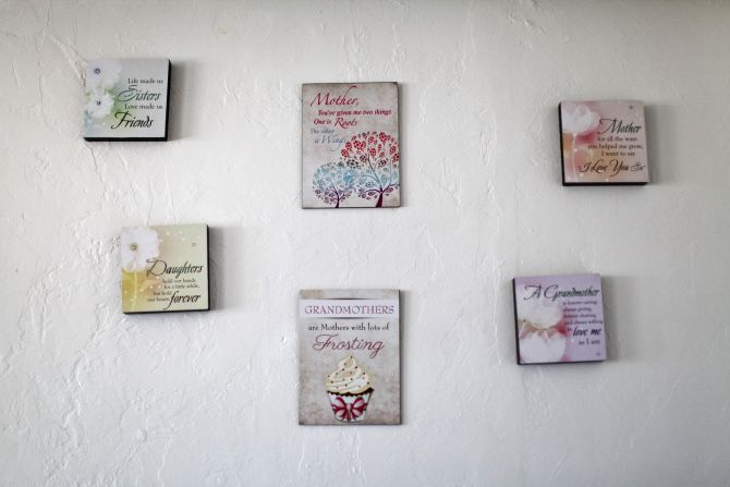 Decorative sayings are pictured on a wall inside the home of Nicole Eason in Tucson, Arizona
