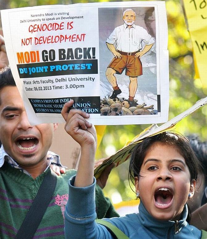 Protestors shout slogans against Modi