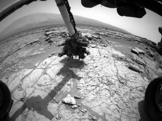 The percussion drill in the turret of tools at the end of the robotic arm of the Mars rover Curiosity is positioned in contact with the rock surface