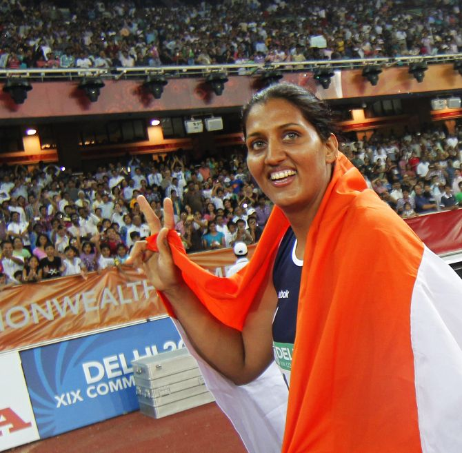 Krishna Poonia celebrates winning gold for the women's discus at the Commonwealth Games in New Delhi