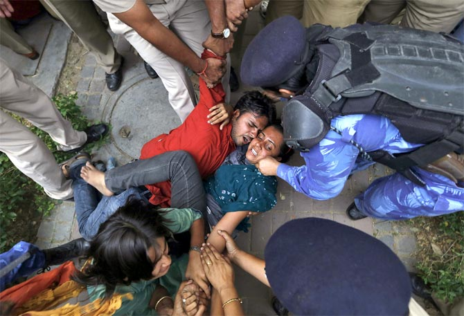 Policemen push protesters during a demonstration against the rising cases of rape in Delhi