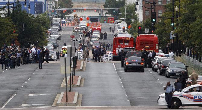 Law enforcement officers cordon off the streets outside the Washington Navy Yard following a shooting in Washington