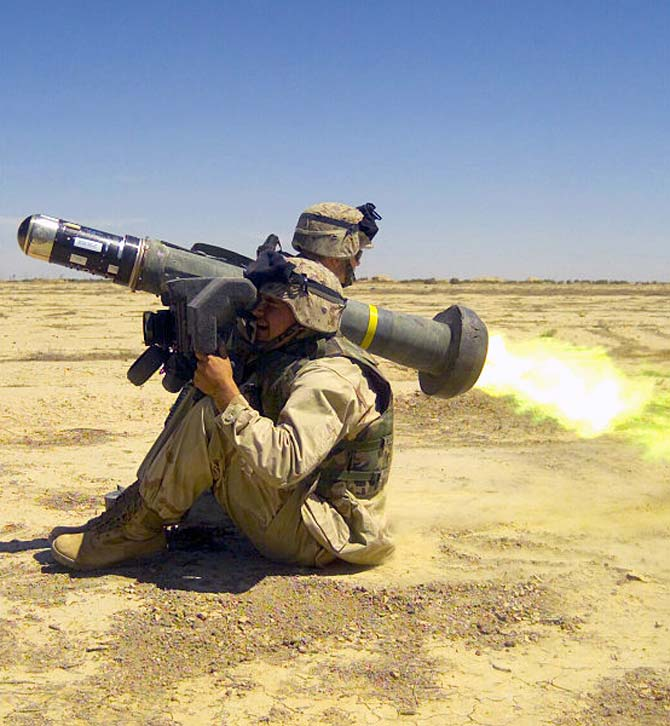 A US Army soldier checks the Javelin's backblast
