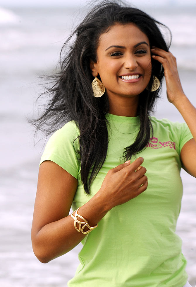 Miss America Nina Davuluri takes a dip In the Atlantic Ocean after being crowned Miss America 2014 at Atlantic City Boardwa