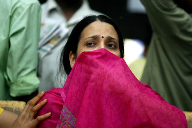 A woman mourns the death of her husband who was killed in the 2006 Mumbai train serial blasts