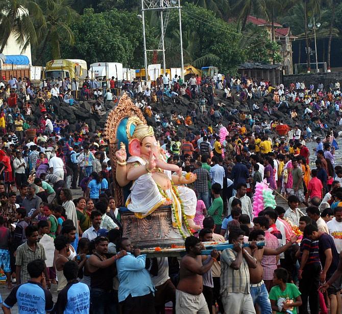 Devotees immerse a Ganesh idol at Dadar chowpatty, Mumbai