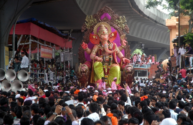 Hundreds of devotees gather near Hindamata as the Ganesh idol from the Tejukya Mansion area in Lalbaug begins his final journey