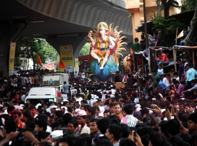 Crowds poured into the streets to get a darshan of Ganpati on the final day of the festival