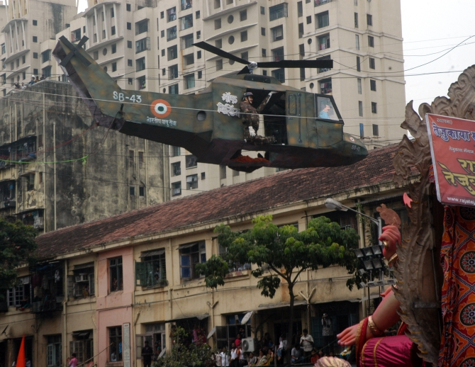 A replica of a helicopter is seen in Lalbaug as the festivities begin on the last day of Ganeshotsav