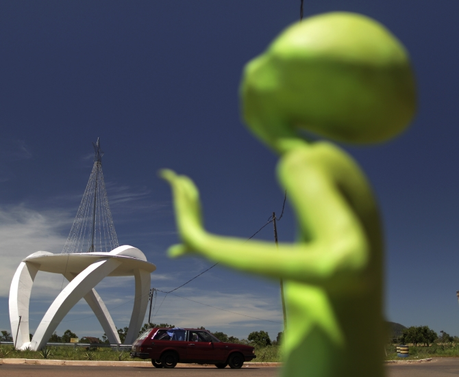 DATE IMPORTED:December 20, 2012An alien figurine stands near the spaceship-shaped entrance to the city of Alto Paraiso de Goias, central Brazil