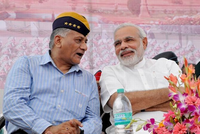 V K Singh speaks with Narendra Modi during the latter's rally in Rewari earlier this week