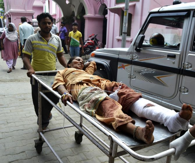 A woman who was injured in communal clashes is rushed to a hospital in Muzaffarnagar