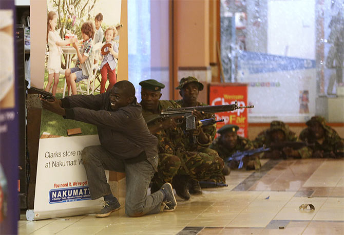 Soldiers and armed police hunt gunmen inside the mall