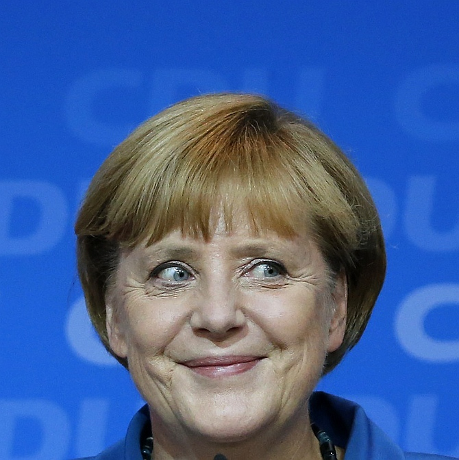 German Chancellor and leader of the Christian Democratic Union Angela Merkel smiles as she addresses supporters at the party headquarters in Berlin