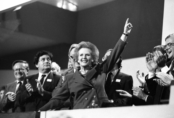 Margaret Thatcher points skyward as she receives standing ovation at Conservative Party Conference on October 13, 1989